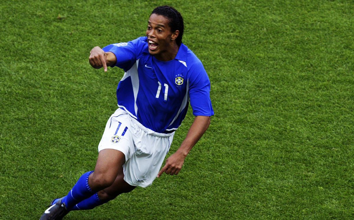SHIZUOKA - JUNE 21: Ronaldinho of Brazil celebrates after scoring Brazil's second goal during the England v Brazil World Cup Quarter Final match played at the Shizuoka Stadium Ecopa in Shizuoka, Japan on June 21, 2002. Brazil won the match 2-1. (Photo by Laurence Griffiths/Getty Images)